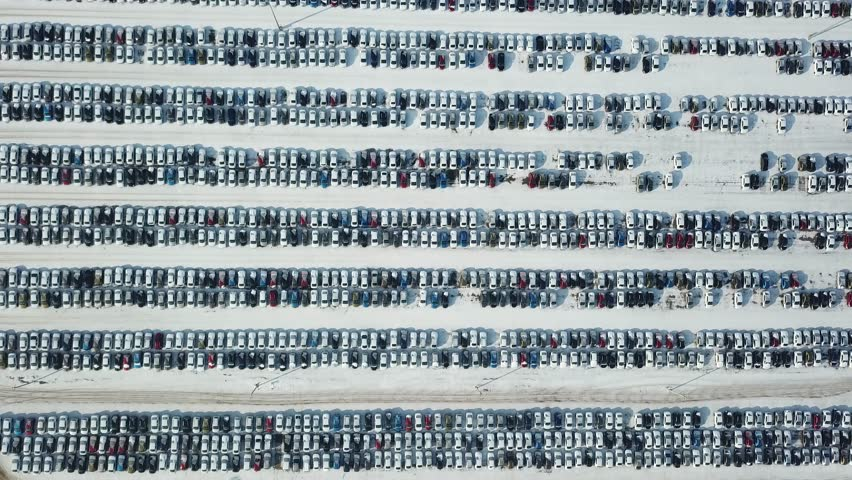 Aerial view of new car storage parking. Car industry.Market for sales in winter. | Shutterstock HD Video #1007521357