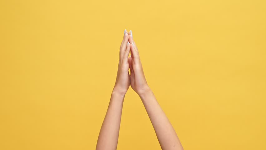 Woman hands clapping and showing thumbs up over yellow background | Shutterstock HD Video #1007574916