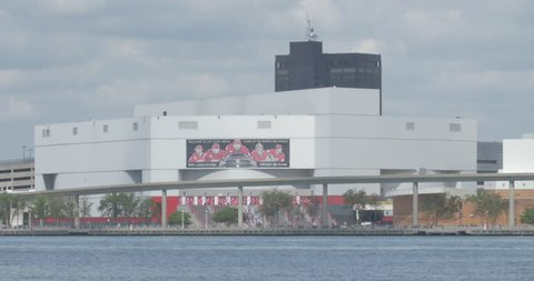 Joe Louis Arena on the Detroit River on a sunny day before game time.