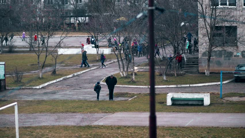 School Children in accelerated shooting leave the school building | Shutterstock HD Video #1007582770