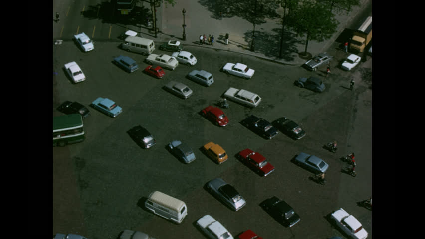 PARIS, 1970, Archival, Traffic rotating the Arch of Triumph, from overhead atop the arch