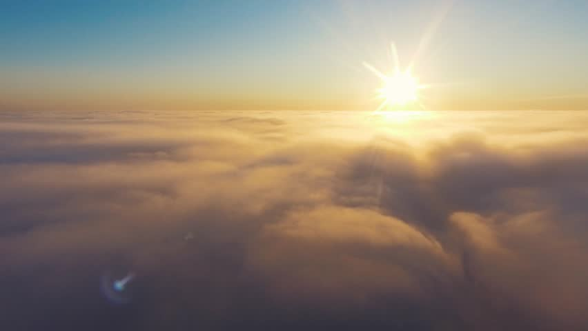 Aerial View. Flying in fog, fly in mist. Aerial camera shot. Flight above the clouds towards the sun. Misty weather, view from above. | Shutterstock HD Video #1007636896
