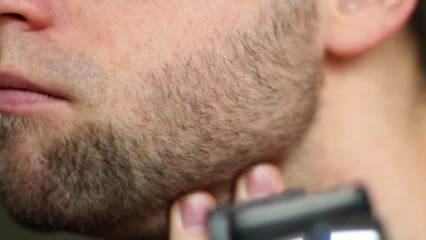 Man Shaving With Electric Razor Close Up