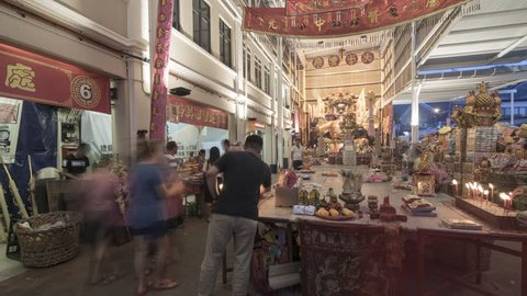BUKIT MERTAJAM, PENANG / MALAYSIA - CIRCA SEP 2017: Timelapse Devotees and public attend the hungry ghost burn joss stick and worship the Tai Su Yeah (King of Hades) in the form of paper.