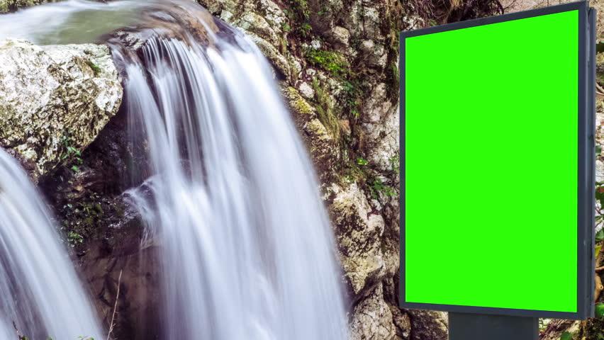 Billboard green screen near the Fabulous waterfall   Shutterstock HD Video #1007703979