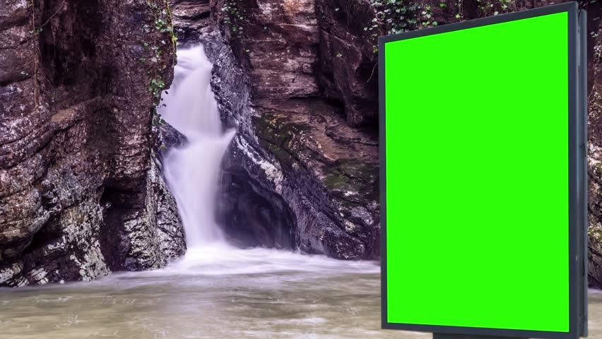 Billboard green screen near the Fabulous waterfall   Shutterstock HD Video #1007704012