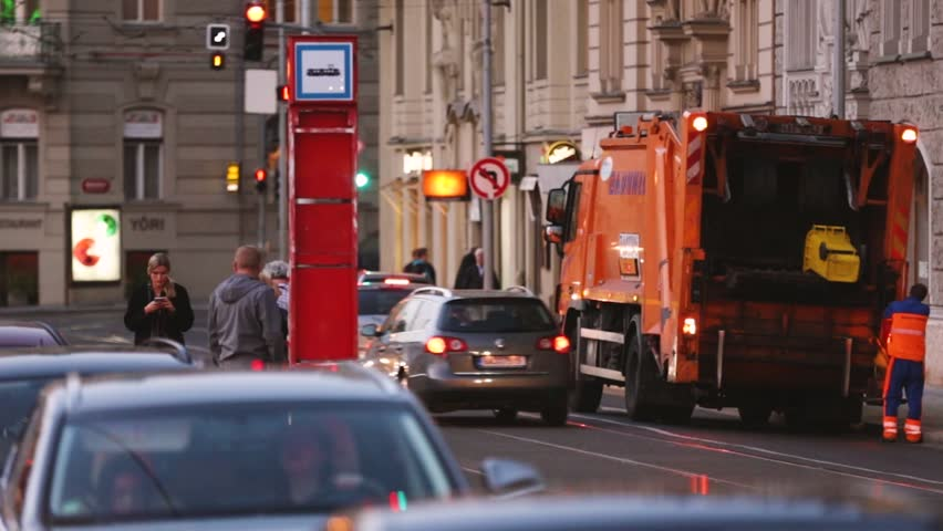 Prague, Czech Republic - September 22, 2017: Automated Garbage Truck Working In Evening Street. Dustcart, Trash Truck, Rubbish Truck, Junk Truck, Dumpster Specially Designed To Collect Municipal Waste