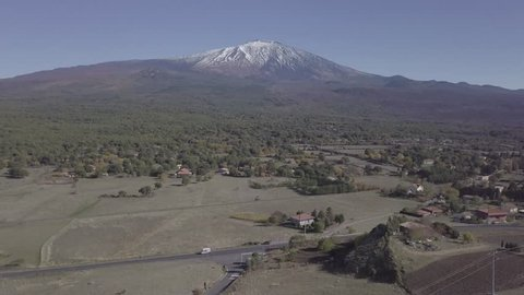 Dlog footage Mount Etna captired with drone. Aerial video flying towards etna volcano.