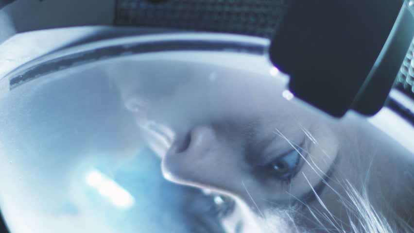Spinning Portrait Shot of the Beautiful Female Astronaut Wearing Helmet in Space, Looking around in Wonder. Space Travel, Exploration and Solar System Colonization Concept. Shot on RED EPIC-W 8K