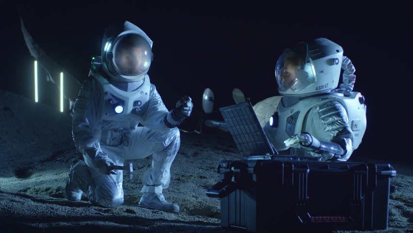 Two Astronauts Collect Rock and Soil Samples on the Alien Planet. Space Travel and Exploration, Finding Habitable Planet, Colonization Concept. Shot on RED EPIC-W 8K Helium Cinema Camera. | Shutterstock HD Video #1007756986