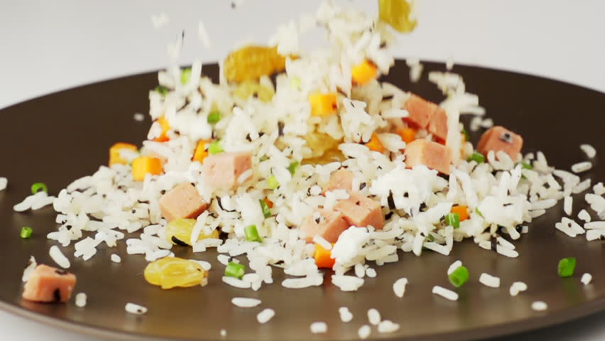 vegetarian fried rice falling to plate, slow motion
