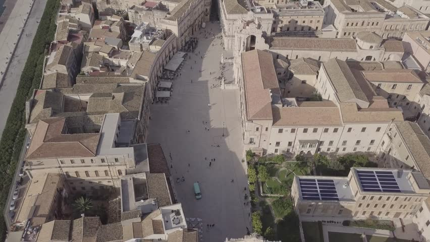 D-log aerial footage by drone, flying over the Island of Ortigia, Syracuse in Sicily, Italy. UNESCO heritage sites - Native Video File