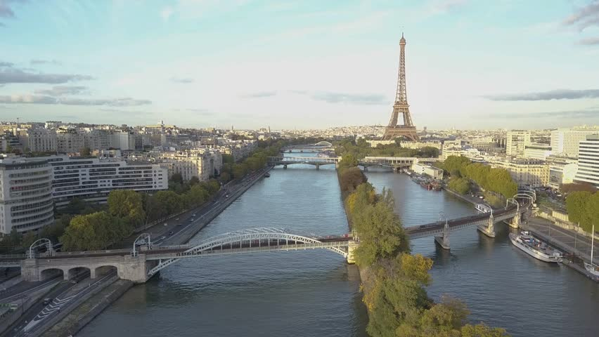 Aerial of Paris Eiffel Tower and Seine River. Train crossing the bridge | Shutterstock HD Video #1007822506