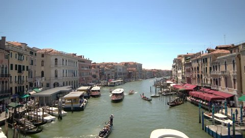 Blue sky beautiful day in Venice, Italy. Canals with gondolas and boats.