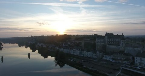 Aerial drone view of a very Nice sunrise at Amboise the Castle, next to the river Loire in France