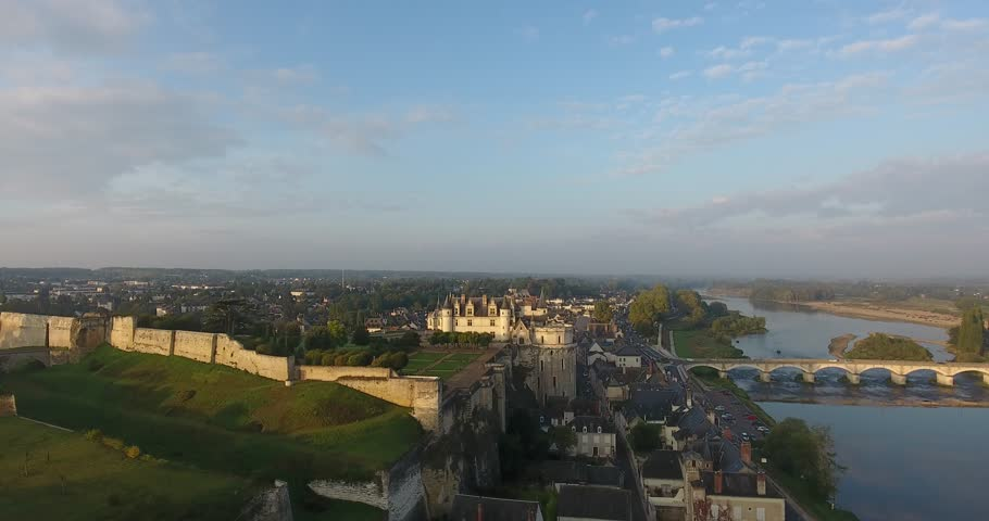Aerial drone flight near the Castle of Amboise near the river Loire at France, in a beautiful light just after sunrise