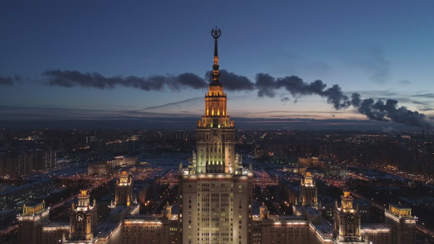 Moscow State University Main Campus and Illuminated Moscow Cityscape at Frosty Winter Twilight. Russia. Aerial View. Drone is Flying Upward. Establishing Shot.  | Shutterstock HD Video #1007851216