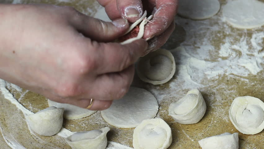Housewife makes homemade pelmeni video, close-up