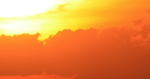 Colorful sunset sun set with billowy clouds silhouette time lapse