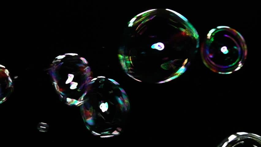 Soap Bubbles against black background shot in slow motion 480fps