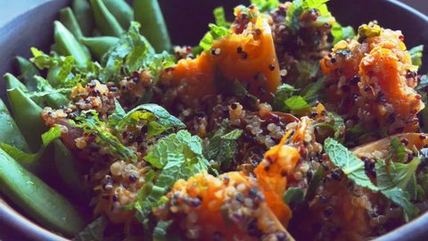 Putting some healthy colourful quinoa salad on a fork in slow motion