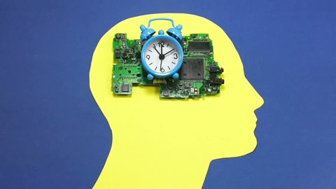 Electronic circuit board and small running alarm bell clock , placed on the yellow contour of a male human head, conceptual footage