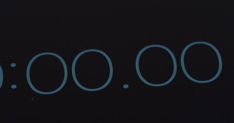Close up of the timer counting seconds and milliseconds on the black  screen  macro