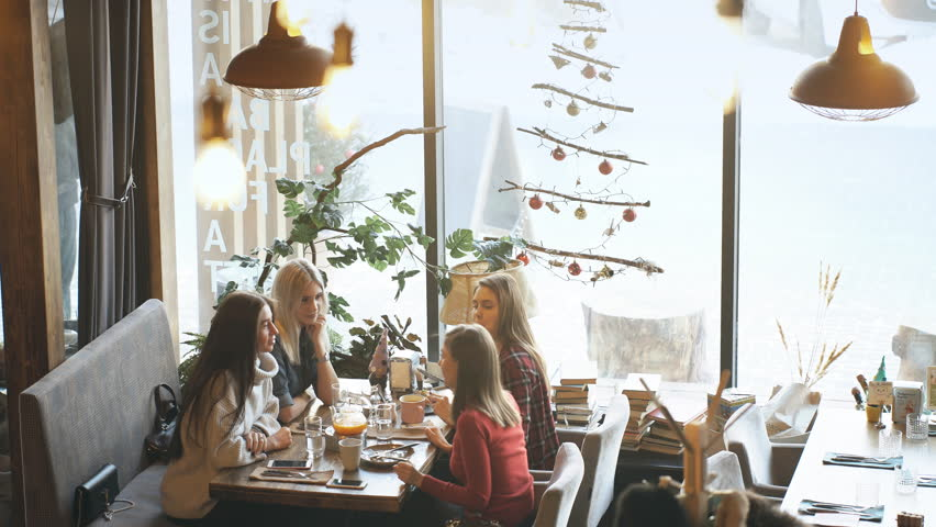 Four friends have Breakfast in a cafe and communicate | Shutterstock HD Video #1008001576