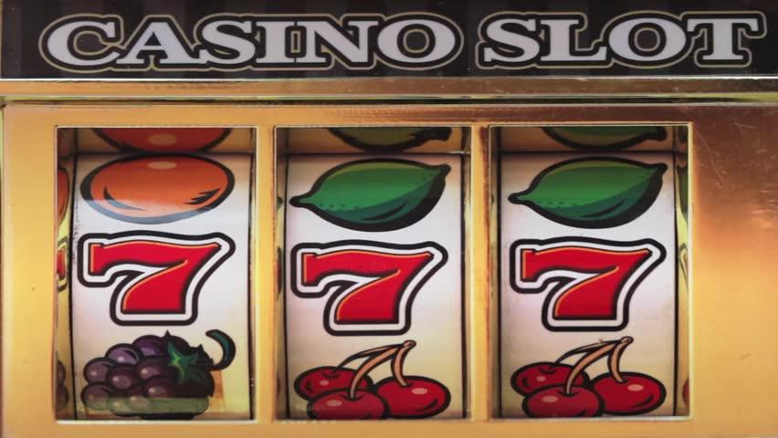 Retro slot machine spinning to win 777 , BAR BAR BAR .  | Shutterstock HD Video #1008012526