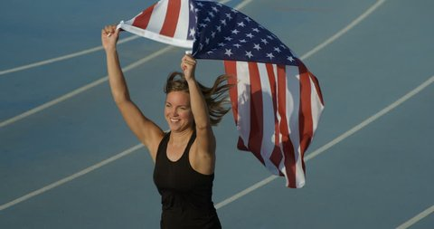 An American Athlete Flying the National Flag of the United States of America, the Stars and Stripes.