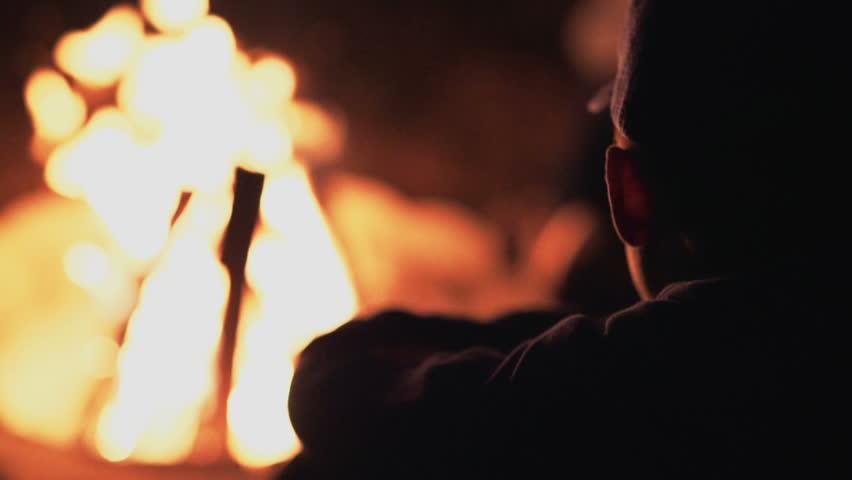 Boy Sitting by Fire