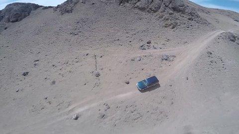 Aerial view of van driving through the Mongolian Gobi Desert
