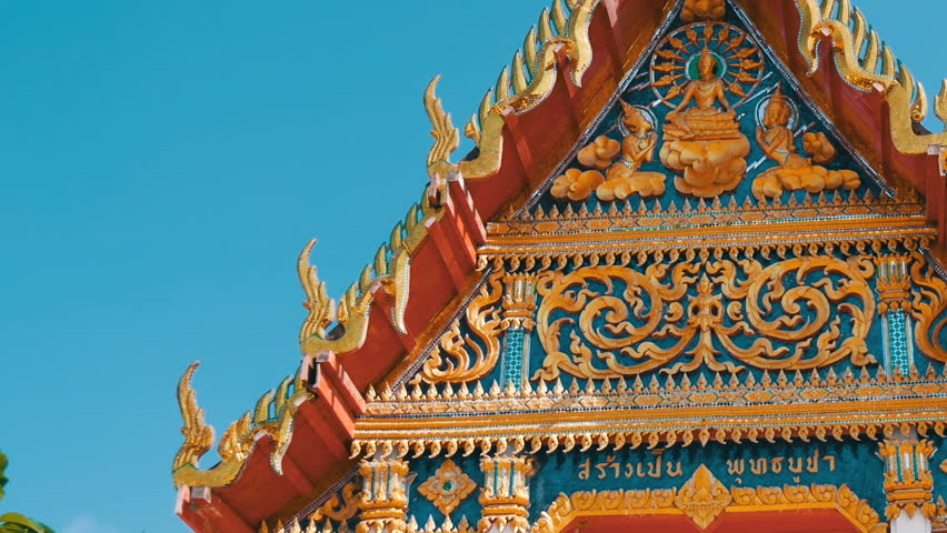 Beautiful Buddhist gilded temple with a variety of ornaments and religious symbols