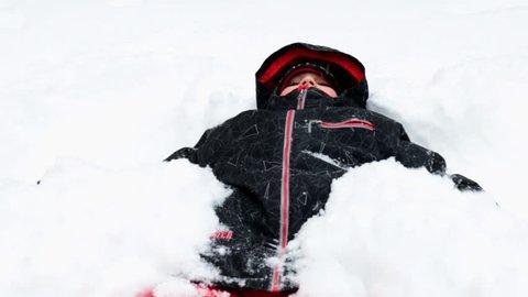 Kid doing a snow angel