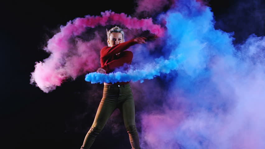 4K Girl is dancing a new style disco contemporary party solo dance with blue color smoke grenade in her hand. Slow motion (150fps) Shooted on Black Background (high quality) | Shutterstock HD Video #1008162136