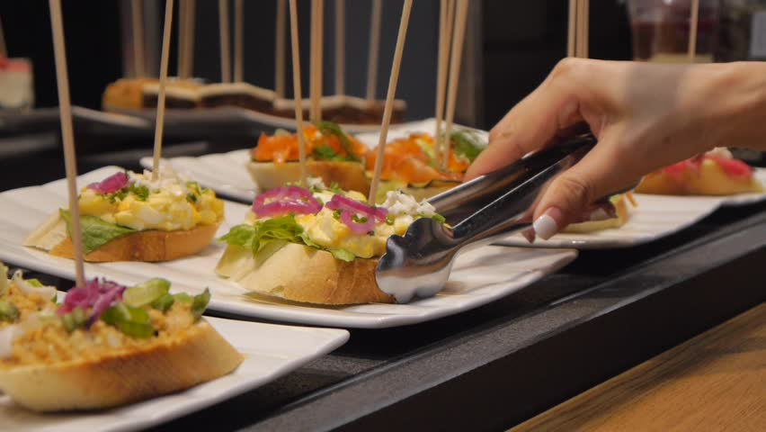 Small catering sandwiches. Tasting ingredients, ham, tuna, salmon and various spreads.