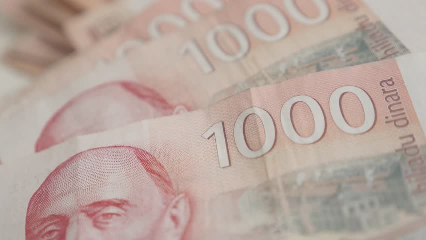 Thousands in Serbian banknotes close-up 4K 2160p 30fps UltraHD panning  footage - Denominations of 1000 dinars slow pan 3840X2160 UHD video