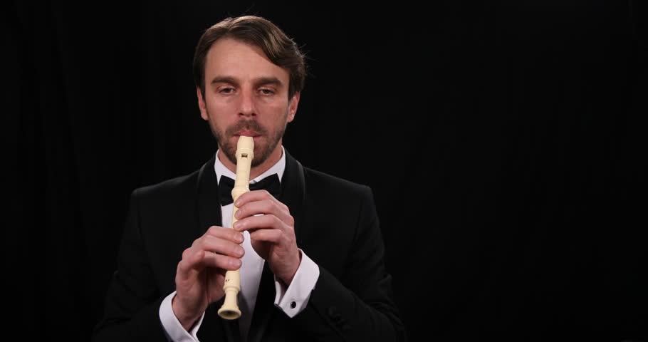 Portrait of Mature Musician Man Sing Flutist Playing Recorder Flute Instrument