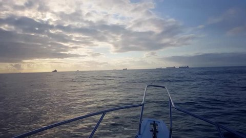 Boat sailing to the high seas. View of ships. Bay of Vitoria, Espirito Santo, Brazil.