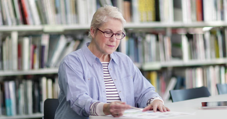Portrait of senior student in college library | Shutterstock HD Video #1008231526