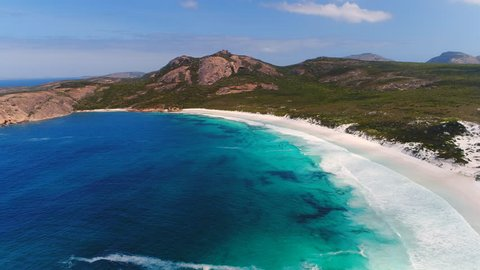Aerial view of picturesque coastline scenery of Hellfire Bay, colorful cliffs and rocks, white sand beach and crystal clear waters - Cape Le Grand, Esperance, Western Australia from above, 4k UHD
