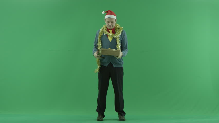 Adult man takes photos of his Christmas present, green chroma key background | Shutterstock HD Video #1008261736