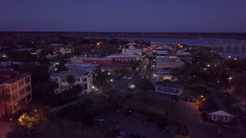 Aerial flyover of small town of Beaufort, South Carolina at night.