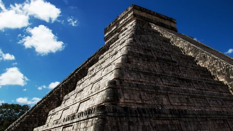Time Lapse of Chichen Itza  pyramid in Yucatan Mexico. Kukulkan step temple. Ancient civilization building made from stone. Famous archaeological and historical site for tourists.