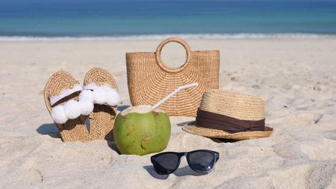 Summer Accessories: Straw Hat, Sunglasses, Bag, Flip Flops On Beach By The Sea