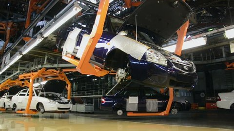 TOGLIATTI - SEP 30: People work at assembly of cars Lada on conveyor of factory AutoVAZ, on September 30, 2011 in Togliatti, Russia.