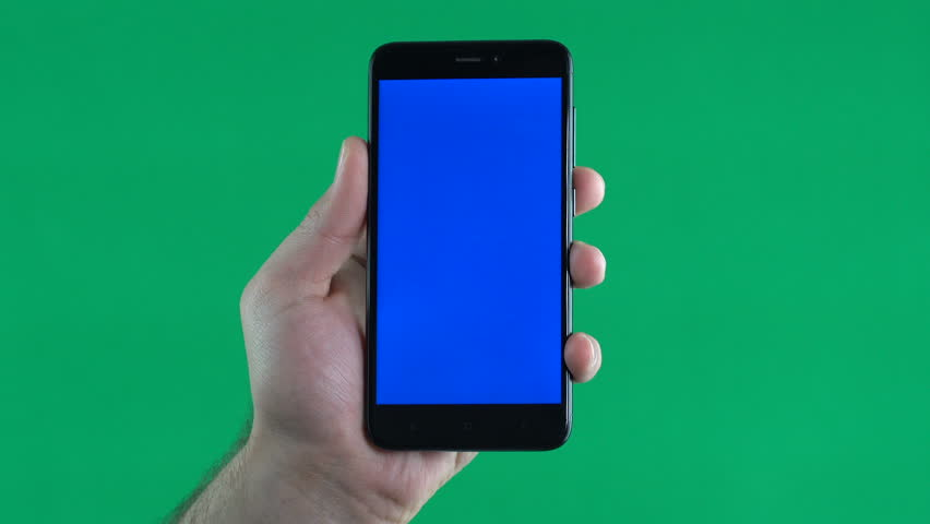 The hand holds the phone with a blue screen, vertically | Shutterstock HD Video #1008297706