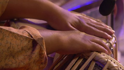 Indian musician playing tabla drum shot in slow motion 100 fps.
