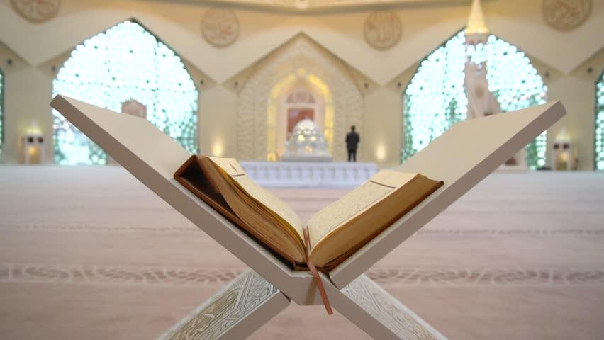 A Muslim man reads a koran or quran in an Islamic mosque | Shutterstock HD Video #1008348106