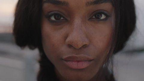 close up portrait of beautiful african american woman looking to camera intense focused